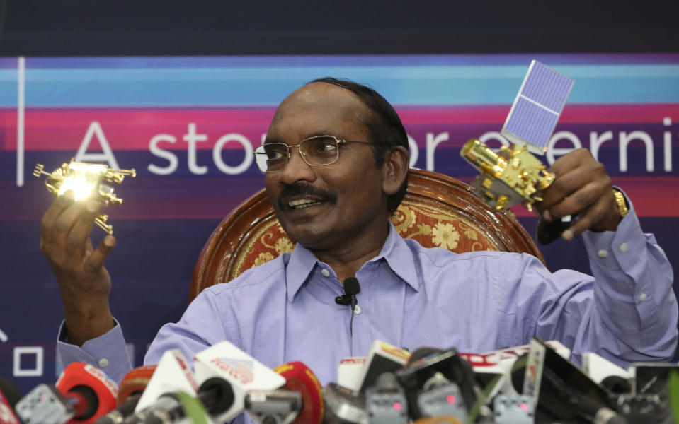 FILE- In this Aug. 20, 2019 file photo, Indian Space Research Organization (ISRO) Chairman Kailasavadivoo Sivan displays a model of Chandrayaan 2 orbiter and rover during a press conference at their headquarters in Bangalore, India. The landing module of India's unmanned moon mission separated from the orbiter on Monday ahead of its planned touchdown on the moon's south polar region this weekend, the space agency said. (AP Photo/Aijaz Rahi, File)