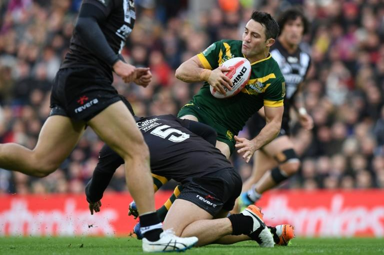 Australia's scrum-half Cooper Cronk (right) is tackled by New Zealand's wing Jordan Rapana during their rugby league Four Nations Final match in Liverpool on November 20, 2016