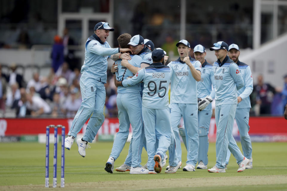 England's Liam Plunkett, second left, celebrates taking the wicket of New Zealand's captain Kane Williamson during the Cricket World Cup final match between England and New Zealand at Lord's cricket ground in London, Sunday, July 14, 2019. (AP Photo/Matt Dunham)