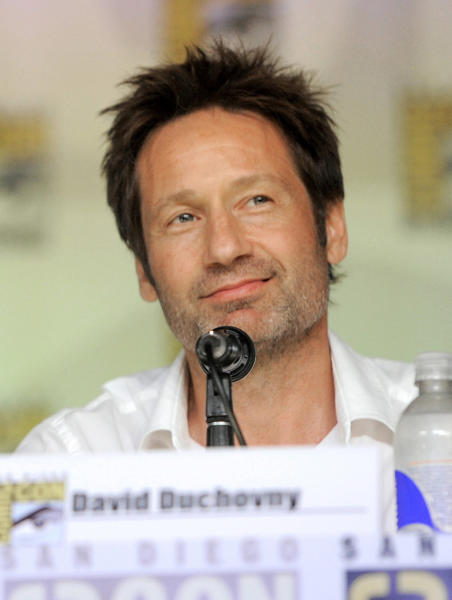 """David Duchovny attends the """"The X Files"""" 20th Anniversary panel on Day 2 of Comic-Con International on Thursday, July 18, 2013 in San Diego, Calif. (Photo by Chris Pizzello/Invision/AP)"""