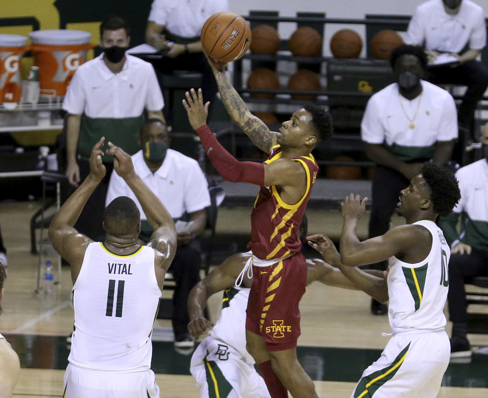 Iowa State guard Tyler Harris (1) scores past Baylor guard Mark Vital (11) in the first half of an NCAA college basketball game, Tuesday, Feb. 23, 2021, in Waco, Texas. (AP Photo/Jerry Larson)