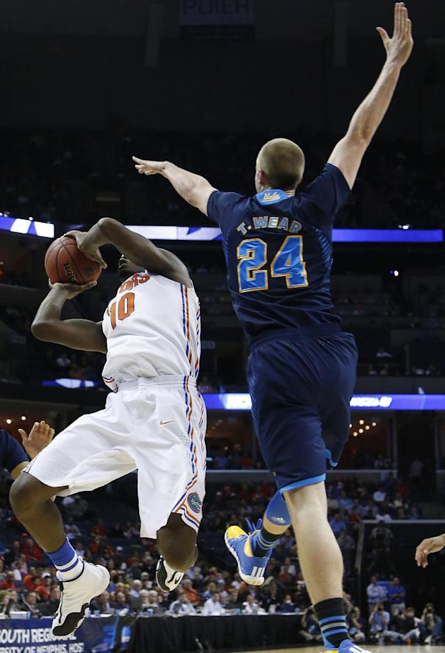 Florida forward Dorian Finney-Smith (10) shoots against UCLA forward Travis Wear (24) during the first half in a regional semifinal game at the NCAA college basketball tournament, Thursday, March 27, 2014, in Memphis, Tenn. (AP Photo/Mark Humphrey)