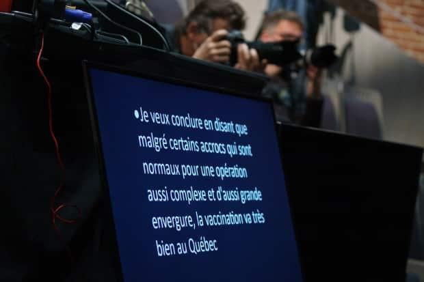 A photograph of a teleprompter at a new conference Wednesday where Quebec officials announced they were expanding vaccine coverage to those with chronic illnesses. By the end of the end, the government was unable to detail which illness would qualify.