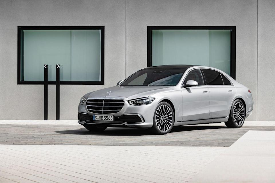 "<p>Boasting spectacular levels of luxury and state-of-the-art technology, the <a href=""https://www.caranddriver.com/mercedes-benz/s-class"" rel=""nofollow noopener"" target=""_blank"" data-ylk=""slk:2021 Mercedes-Benz S-class"" class=""link rapid-noclick-resp"">2021 Mercedes-Benz S-class</a> sedan is <a href=""https://www.caranddriver.com/mercedes-benz"" rel=""nofollow noopener"" target=""_blank"" data-ylk=""slk:the German company's"" class=""link rapid-noclick-resp"">the German company's</a> flagship and a rolling statement of success. Although its storied history is partly responsible for that prestige, the latest generation looks to improve on its impressive predecessor in every way. The new S-class has grander proportions, an even richer interior, innovative safety equipment, and some seriously futuristic features. The highlights include a 3D gauge cluster, a massive OLED touchscreen, rear-wheel steering for better maneuverability, and an active air suspension that makes cornering smoother and keeps passengers safer in the event of a collision. A pair of turbocharged powertrains and standard all-wheel drive should ensure that the 2021 S-class sedan can whisk you to business meetings or gala events on time, but its indulgent amenities and lounge-like back seat could be a reason to be fashionably late.</p><p><a class=""link rapid-noclick-resp"" href=""https://www.caranddriver.com/mercedes-benz/s-class"" rel=""nofollow noopener"" target=""_blank"" data-ylk=""slk:Review, Pricing, and Specs"">Review, Pricing, and Specs</a></p>"