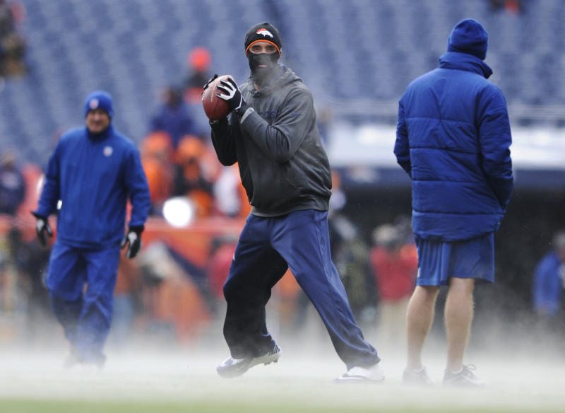 Denver Broncos quarterback Brock Osweiler warms up in seven degree Fahrenheit temperatures before playing the Baltimore Ravens in an AFC divisional playoff NFL football game, Saturday, Jan. 12, 2013, in Denver.  (AP Photo/Jack Dempsey)