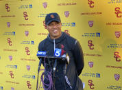 Southern California interim head football coach Donte Williams smiles while answering questions after practice on Tuesday, Sept. 14, 2021 in Los Angeles. Williams became the first Black head coach in Trojans history when he replaced the fired Clay Helton. (AP Photo/Greg Beacham)
