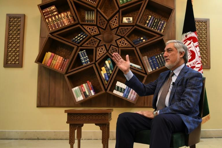 Afghan Chief Executive Abdullah Abdullah gestures during an interview with AFP at the Sapedar Palace in Kabul