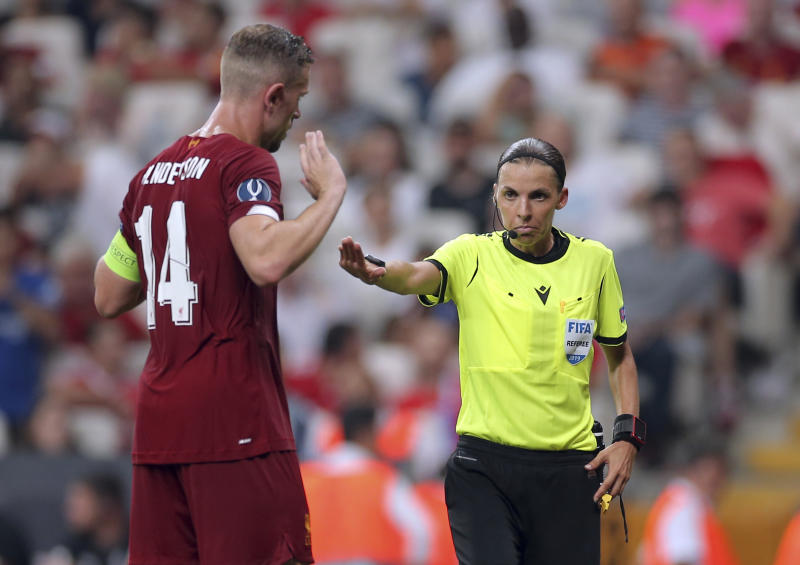 Referee Stephanie Frappart of France, right, discusses with Liverpool's Jordan Henderson during the UEFA Super Cup soccer match between Liverpool and Chelsea, in Besiktas Park, in Istanbul, Wednesday, Aug. 14, 2019. (AP Photo)