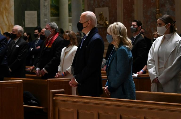 US President-elect Joe Biden and incoming first lady Jill Biden attend Mass at the Cathedral of St. Matthew the Apostle in Washington