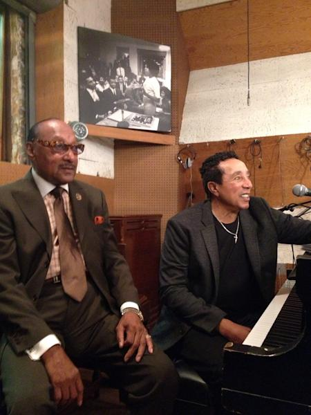 """The Four Tops' Abdul """"Duke"""" Fakir, left, sits with Smokey Robinson Monday, Aug. 26, 2013 at the Motown Historical Museum in Detroit. Robinson was at the museum to pay tribute to another pioneer, Maxine Powell, who was responsible for developing the charm, grace and style of the legendary Detroit label's roster of artists. (AP Photo/Jeff Karoub)"""