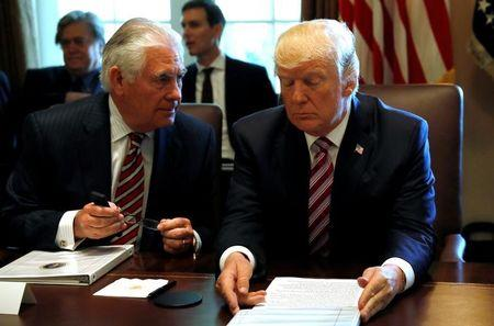 U.S. President Trump talks with Secretary of State Tillerson during a meeting with members of his Cabinet at the White House in Washington