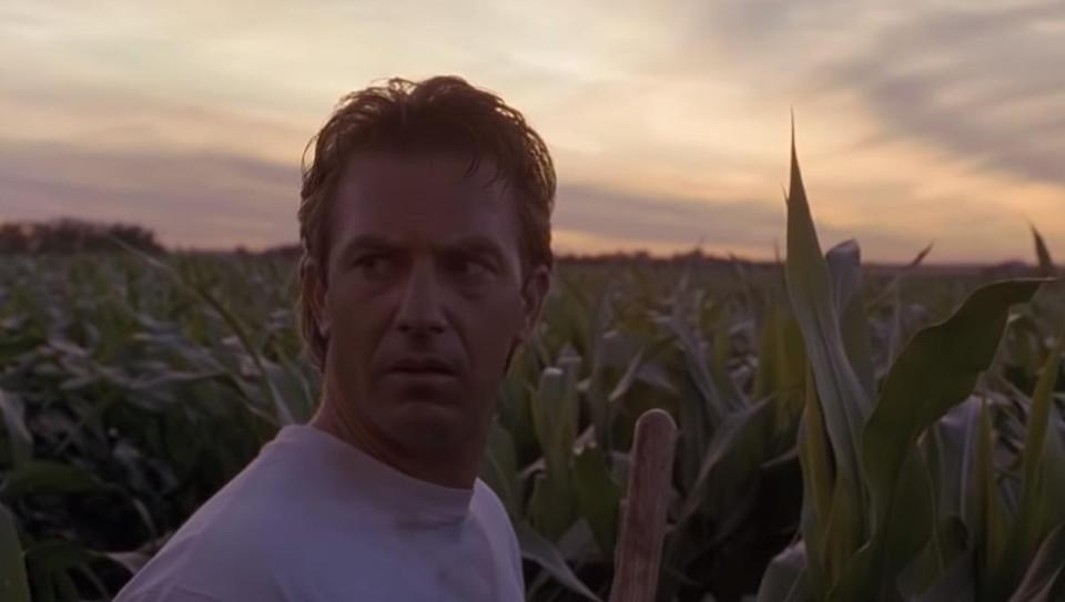 """We still get misty-eyed every time we watch <strong>Kevin Costner's</strong> love letter to baseball, <em>Field of Dreams</em>. But as much as we think we know the story inside and out, we still get <a href=""""https://www.youtube.com/watch?v=5Ay5GqJwHF8"""" rel=""""nofollow noopener"""" target=""""_blank"""" data-ylk=""""slk:this timeless line"""" class=""""link rapid-noclick-resp"""">this timeless line</a> wrong. The voice that Costner's character hears in the crop field isn't promising an abundance of people. The line is actually, """"If you build it, <em>he</em> will come."""" The """"he"""" in question is Shoeless Joe Jackson and, well, we don't want to spoil the movie for you."""