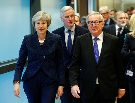 European Commission President Jean-Claude Juncker walks with British Prime Minister Theresa May at the European Commission headquarters in Brussels, Belgium February 7, 2019. REUTERS/Francois Lenoir