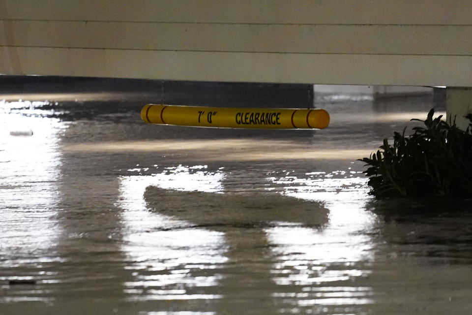 Flooding reaches close to a 7-foot clearance sign in the Manayunk section of Philadelphia on Thursday.