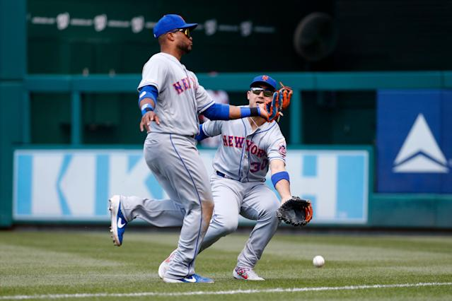 "New York Mets right fielder Michael Conforto, right, collides with second baseman Robinson Cano as they fail to catch a fly ball that was hit by Washington Nationals' <a class=""link rapid-noclick-resp"" href=""/mlb/players/7746/"" data-ylk=""slk:Howie Kendrick"">Howie Kendrick</a> in the fifth inning of a baseball game, Thursday, May 16, 2019, in Washington. Conforto left the game after the play. (AP Photo/Patrick Semansky)"