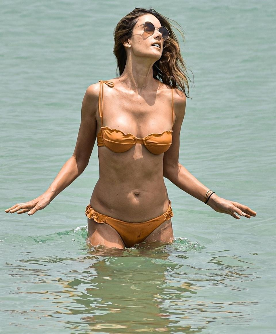<p>Alessandra Ambrosio cools off in the sea of Florinópolis while enjoying her vacation in Brazil on July 26.</p>