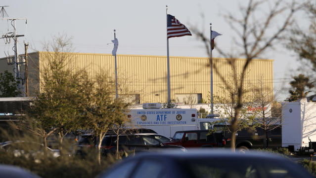 <p>An ATF vehicle sits in front of a FedEx distribution center where a package exploded, Tuesday, March 20, 2018, in Schertz, Texas. Authorities believe the package bomb is linked to the recent string of Austin bombings. (Photo: Eric Gay/AP) </p>