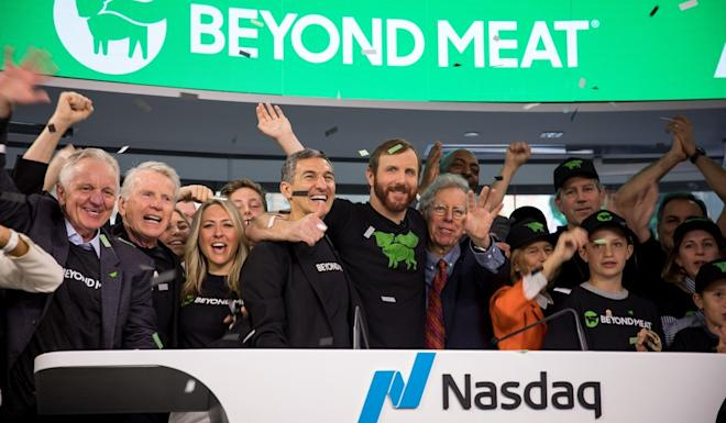 Ethan Brown, founder and CEO of Beyond Meat, centre, rings the opening bell during the company's initial public offering on Nasdaq, on May 2, 2019. Photo: Bloomberg