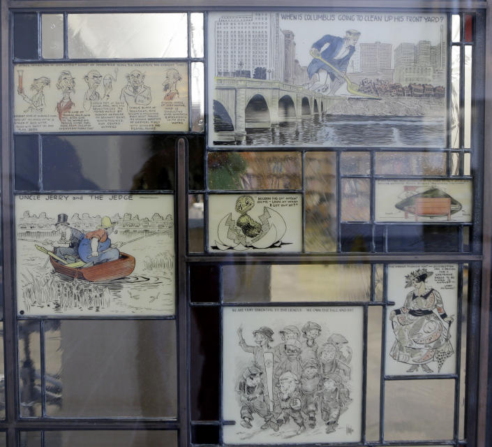 """This Wednesday, Oct. 23, 2013 photo shows stained glass pieces from """"The Passing Show"""" at the Billy Ireland Cartoon Library & Museum in Columbus, Ohio. Today the museum collection includes more than 300,000 original strips from everybody who's anybody in the newspaper comics world, plus 45,000 books, 29,000 comic books and 2,400 boxes of manuscript material, correspondence and other personal papers from artists. (AP Photo/Tony Dejak)"""