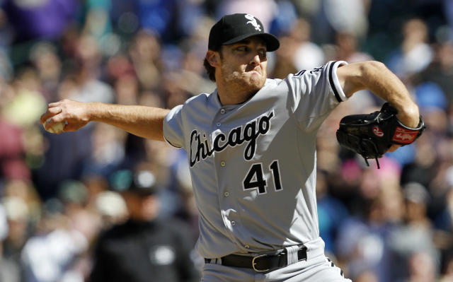Chicago White Sox starting pitcher Phil Humber throws to the final batter while pitching a perfect baseball game against the Seattle Mariners, Saturday, April 21, 2012, in Seattle. The White Sox won 4-0. (AP Photo/Elaine Thompson)