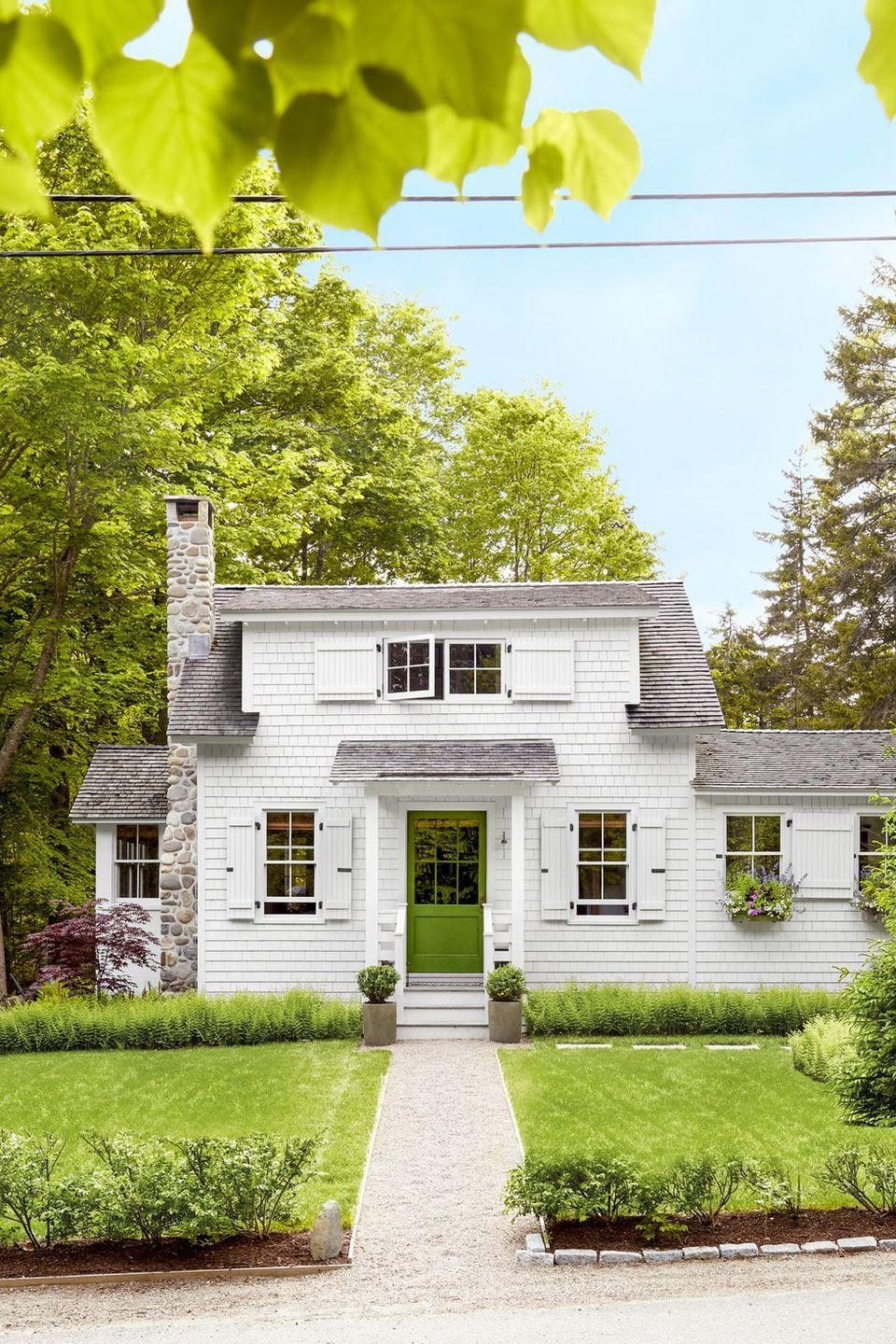 """<p>Create the coziest cottage with this warm shade of green that will match a thriving lawn.</p><p><a class=""""link rapid-noclick-resp"""" href=""""https://store.benjaminmoore.com/storefront/color-samples/paint-color-samples-1-pint/prodPRM01A.html?sbcColor=2029_10"""" rel=""""nofollow noopener"""" target=""""_blank"""" data-ylk=""""slk:SHOP GREEN PAINT"""">SHOP GREEN PAINT</a></p>"""