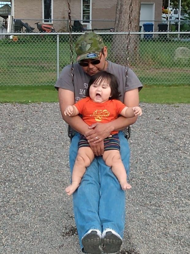 Wesley White with his father, Warren. The family believes the baby's developmental delays are caused by the way he was delivered at a Prince George hospital last June. (Submitted by Kristy White - image credit)