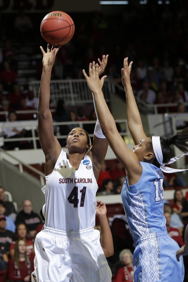 South Carolina center Alaina Coates (41) shoots over North Carolina guard Allisha Gray during the first half of a regional semifinal at the NCAA college basketball tournament in Stanford, Calif., Sunday, March 30, 2014. (AP Photo/Marcio Jose Sanchez)
