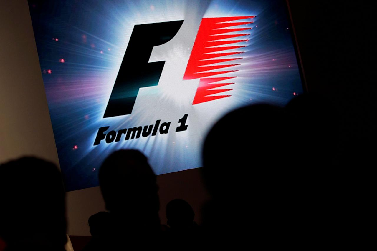FILE PHOTO: Reporters are silhouetted by a screen showing a F1 logo during a news conference in Mexico City, Mexico, July 23, 2014.   REUTERS/Daniel Becerril/File Photo