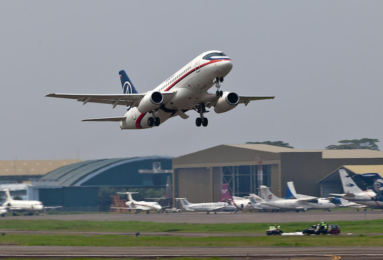 In this photo released by Sergey Dolya, a Sukhoi Superjet-100 takes off from Halim Perdanakusuma airport in Jakarta, Indonesia, Wednesday, May 9, 2012 on it's second demonstration flight of the day. The Russian-made Sukhoi jet plane with 50 people on board, including eight Russians and an American, has gone missing during this flight near Jakarta, Indonesian government officials said Wednesday.(AP Photo/Sergey Dolya) NO SALES