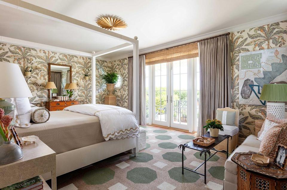 "<p>When you think serene, you might not think pattern-filled, but this bedroom by Courney Giles proves the two can go hand-in-hand. ""I wanted like a serene and calm vibe but also beachy,"" says Giles. <strong>By sticking to a tonal palette, she manages to pack in a variety of patterns without overwhelming the space. </strong>With their sage, beige, and ochre tones, the handpainted sisal rug by Mary Meade Evans, Blair Palm wallpaper by Schumacher, and original artwork by Katie Madden evoke a dreamy, relaxed feel. </p>"