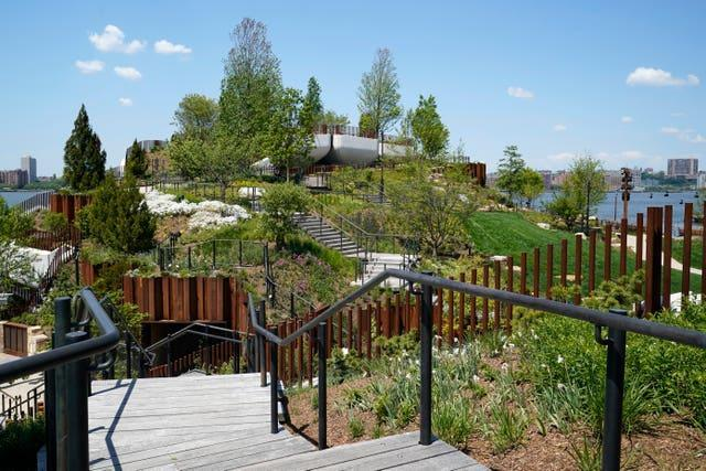 A stairway leads to one of the highest points of Little Island, a new Hudson River Park in New York