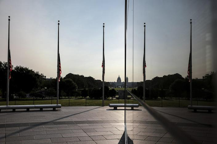 Flags encircling the Washington Monument are flown at half-staff