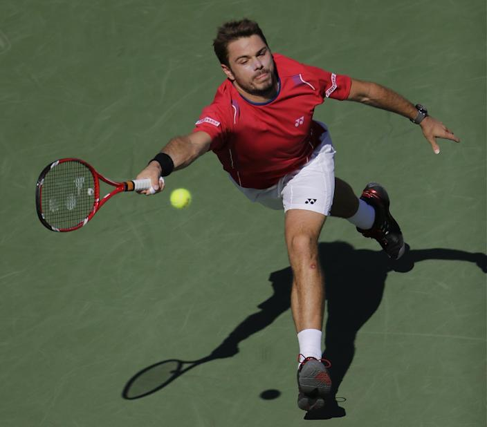 Stanislas Wawrinka, of Switzerland, returns a shot at the net to Andy Murray, of Great Britain, during the quarterfinals of the 2013 U.S. Open tennis tournament, Thursday, Sept. 5, 2013, in New York. (AP Photo/Mike Groll)