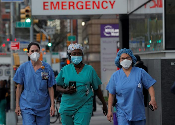 Healthcare workers walk outside NYU Langone Medical Center in New York City on April 20.