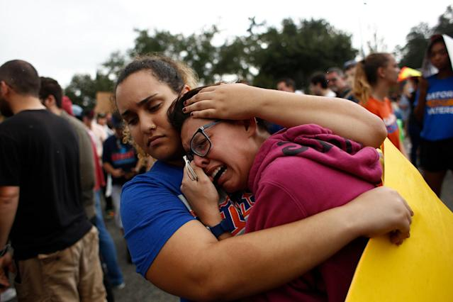 <p>A woman cries and is comforted by a demonstrator after she was refused entry into a planned speech by Richard Spencer, a white nationalist who popularized the term 'alt-right', at the University of Florida campus on Oct.19, 2017 in Gainesville, Fla. (Photo: Brian Blanco/Getty Images) </p>