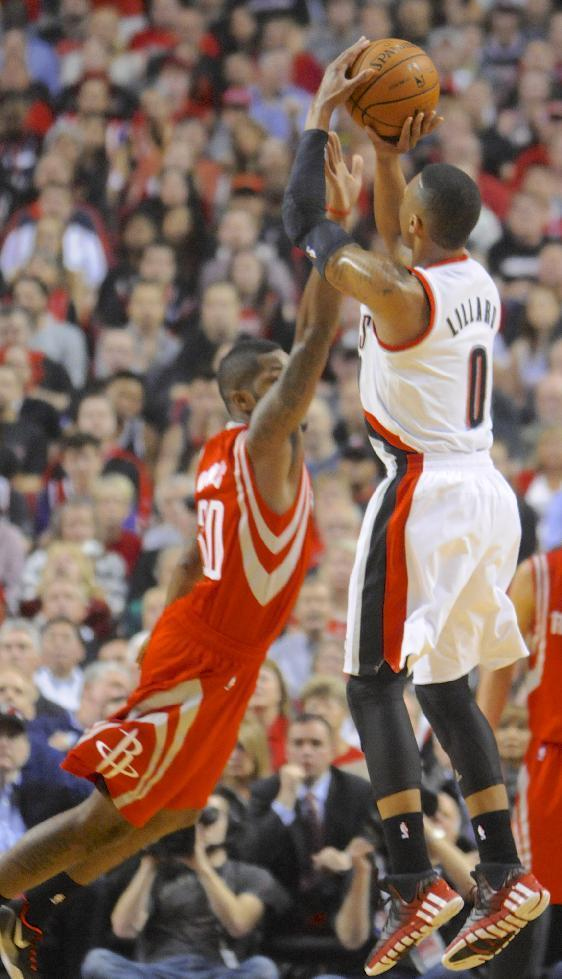 Houston Rockets' Troy Daniels (30) defends against Portland Trail Blazers' Damian Lillard (0) during the first half of game six of an NBA basketball first-round playoff series game in Portland, Ore., Friday May 2, 2014. (AP Photo/Greg Wahl-Stephens)