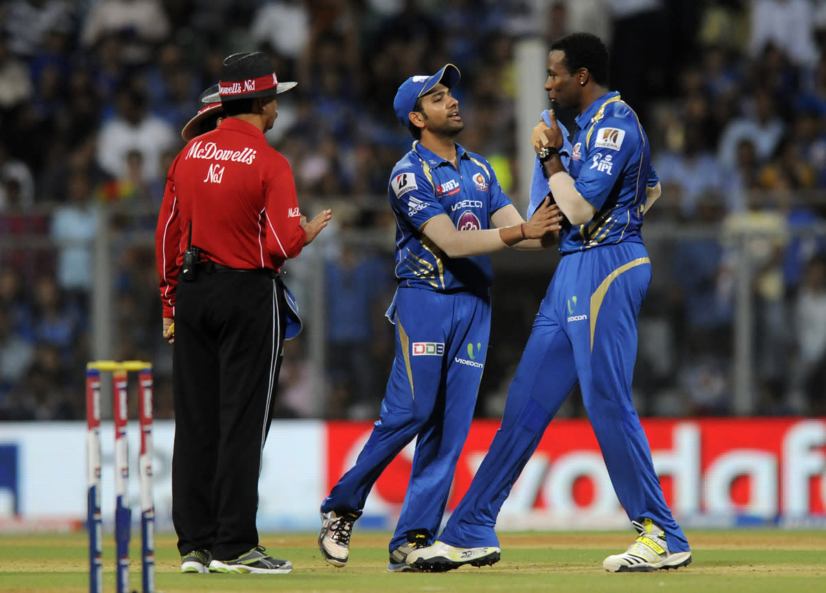 Rohit sharma captain of Mumbai Indians with teammate Kieron Pollard of Mumbai Indians have a chat with the field umpires  during match 66 of the Pepsi Indian Premier League ( IPL) 2013  between The Mumbai Indians and the Rajasthan Royals held at the Wankhede Stadium in Mumbai on the 15th May 2013 ..Photo by Pal Pillai-IPL-SPORTZPICS ..Use of this image is subject to the terms and conditions as outlined by the BCCI. These terms can be found by following this link:..http://www.sportzpics.co.za/image/I0000SoRagM2cIEc