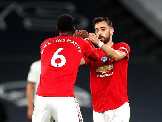 Bruno Fernandes, right, celebrates with Paul Pogba (PA)
