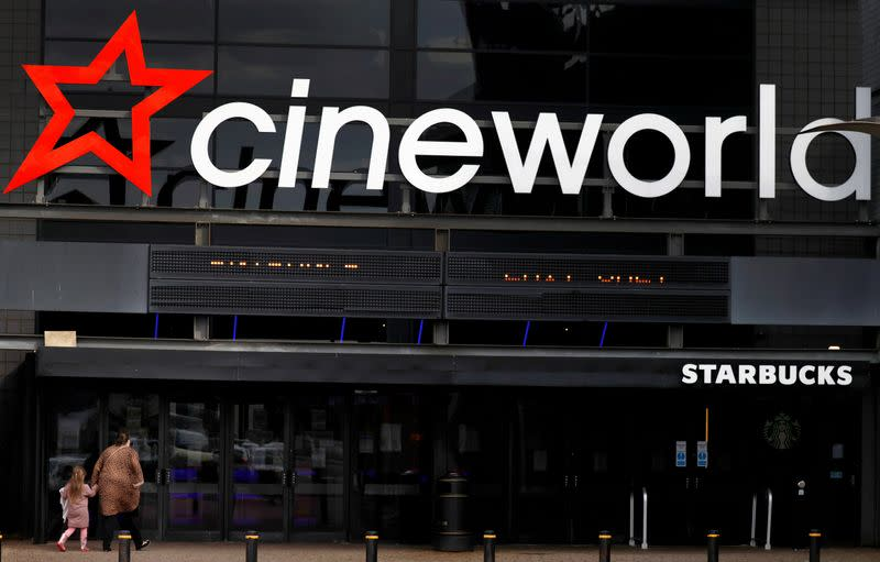 FILE PHOTO: People enter a Cineworld cinema following the outbreak of the coronavirus disease (COVID-19) near Manchester