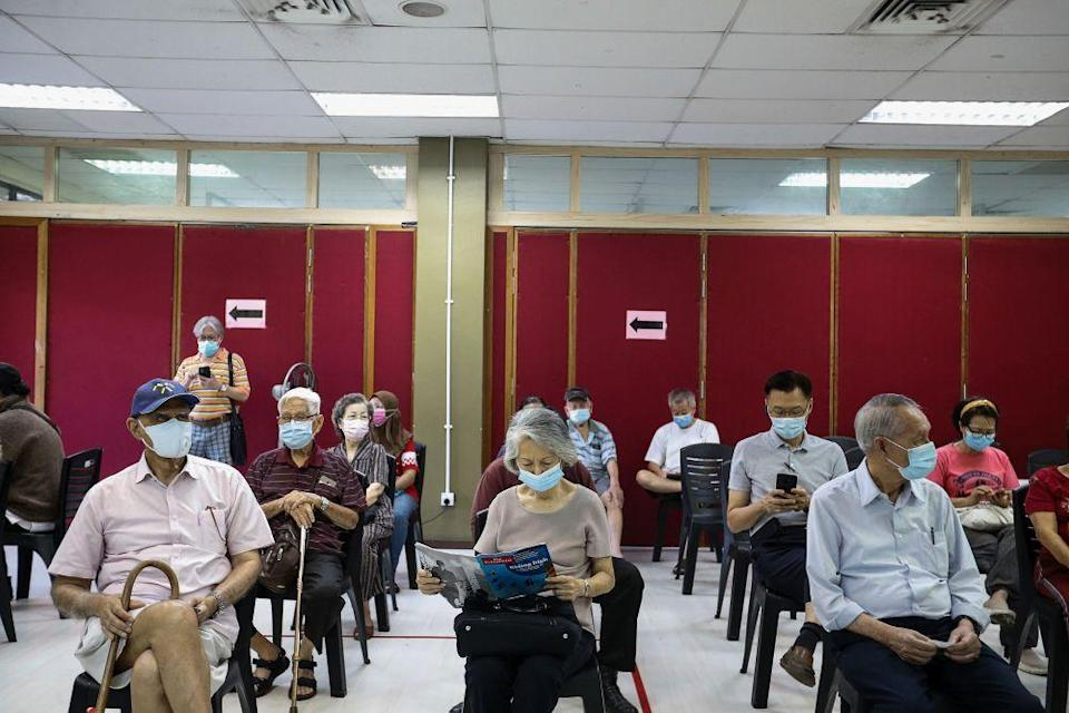 Senior citizens wait to receive their Covid-19 shot under phase two of Penang's immunisation drive at the Caring Society Complex in George Town April 19, 2021. — Picture by Sayuti Zainudin