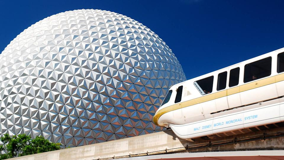 Monorail passing in front of Spaceship Earth at Epcot Center in Walt Disney World
