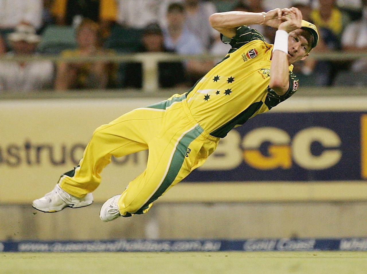 PERTH, AUSTRALIA - JANUARY 30:  Brett Lee of Australia dives to catch Shahid Afridi of Pakistan during game eight of the VB Series One Day International Tournament between Australia and Pakistan played at the WACA on January 30, 2005 in Perth, Australia. (Photo by Hamish Blair/Getty Images)