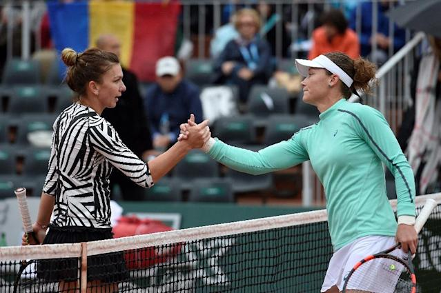 Australia's Samantha Stosur (R) shakes hands with Romania's Simona Halep after their fourth round match at the Roland Garros French Open in Paris on May 31, 2016 (AFP Photo/Miguel Medina)