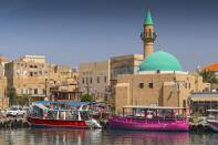 Port of Akko (Acre) with boats, mosque and the old city in the background, Israel. Heritage sites around the world are under threat due to conditions created by climate change. Increased risk for floods or fire put some of the world's most famous monuments and locations in jeopardy. (Getty)
