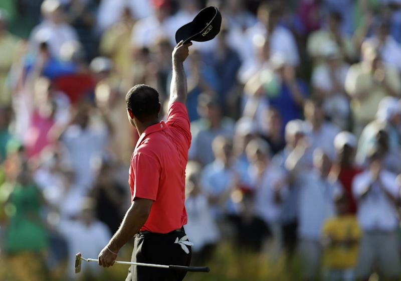 Tiger Woods acknowledges the gallery on the 18th green after winning the AT&T National golf tournament at Congressional Country Club in Bethesda, Md., Sunday, July 1, 2012. (AP Photo/Patrick Semansky)