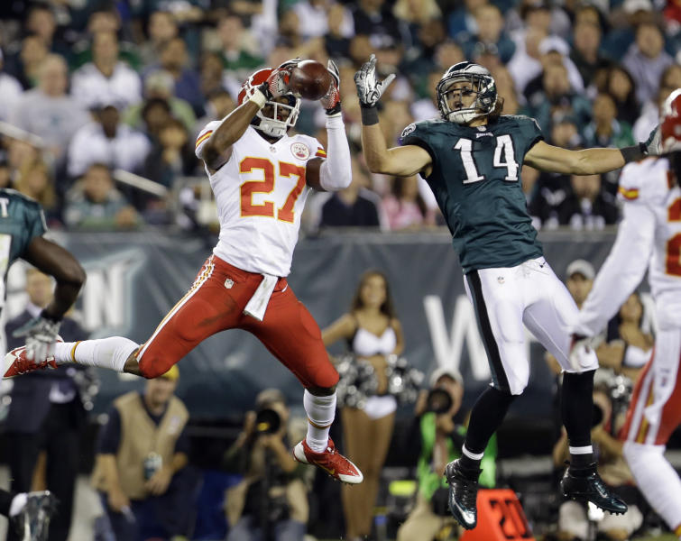 Kansas City Chiefs' Sean Smith (27) intercepts a pass intended for Philadelphia Eagles' Riley Cooper (14) during the first half of an NFL football game, Thursday, Sept. 19, 2013, in Philadelphia. (AP Photo/Julio Cortez)