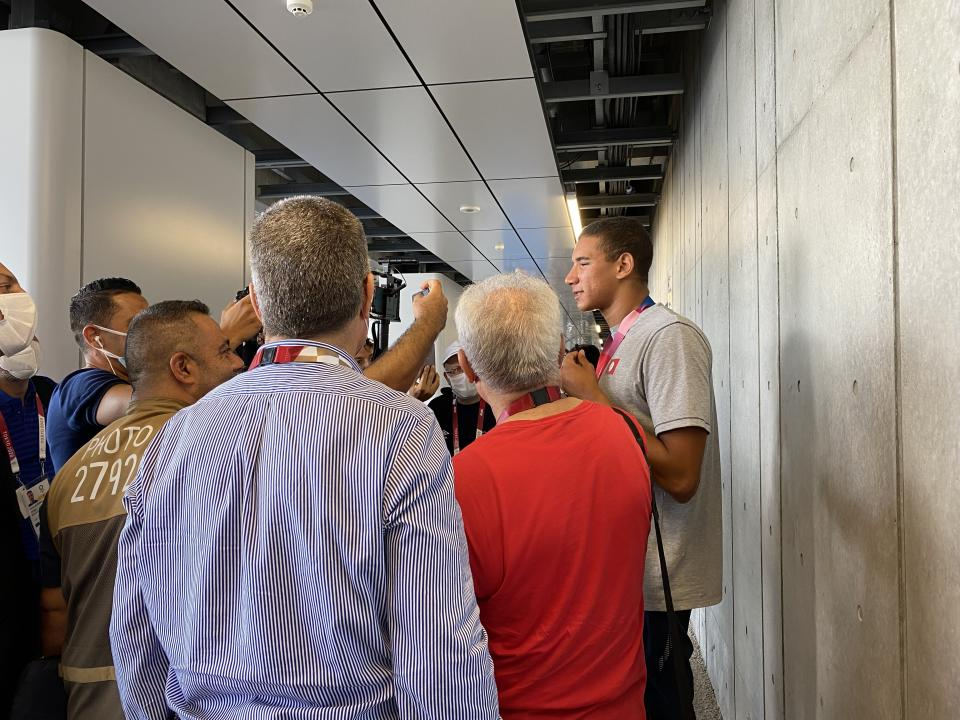 Ahmed Hafnaoui does his umpteenth interview after winning a stunning gold medal in Tokyo. (Henry Bushnell/Yahoo Sports)