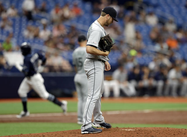 Seattle Mariners pitcher Wade LeBlanc reacts as Tampa Bay Rays' Guillermo Heredia runs around the bases after his solo home run during the third inning of a baseball game Wednesday, Aug. 21, 2019, in St. Petersburg, Fla. (AP Photo/Chris O'Meara)