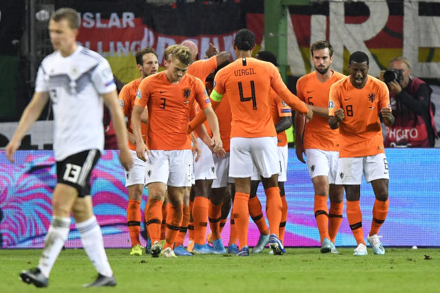 Netherlands' players celebrate after scoring their third goal during the Euro 2020 group C qualifying soccer match between Germany and the Netherlands at the Volksparkstadion in Hamburg, Germany, Friday, Sept. 6, 2019. (AP Photo/Martin Meissner)