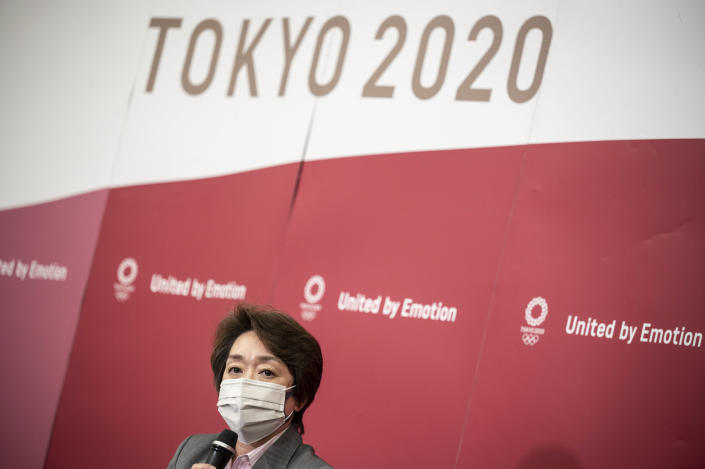 Seiko Hashimoto, president of Tokyo 2020 attends a media huddle following the IOC Executive Board Meeting at the Tokyo 2020 headquarters in Tokyo, Wednesday, April 21, 2021. (Philip Fong/ Pool Photo via AP)